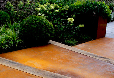 greencube garden design uses interesting weathered steel for a path in walsingham norfolk