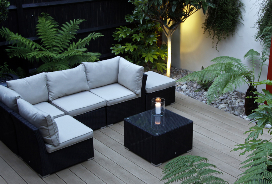 millboard decking used by greencube garden design in this modern garden design in caterham, surrey