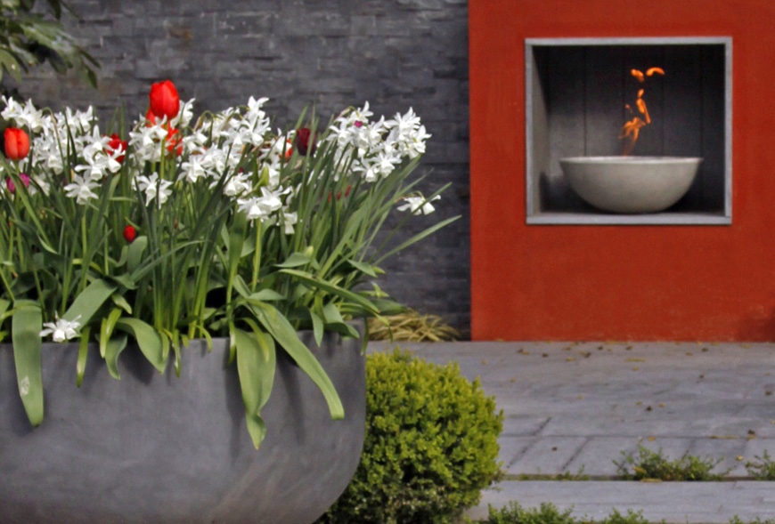 outdoor fireplace in new barn, kent by greencube garden design